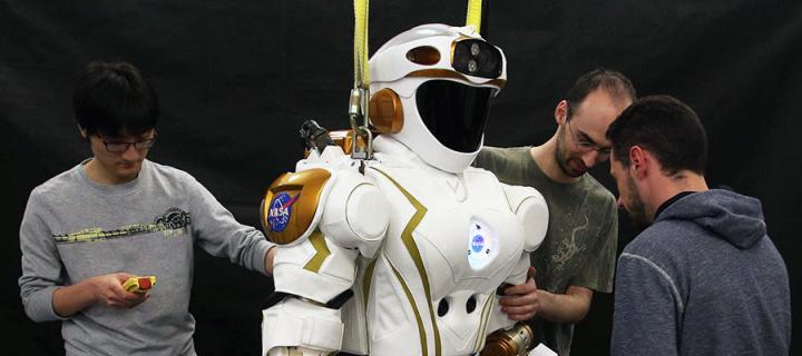 Photo of PhD students and researchers working on NASA's Valkyrie robot