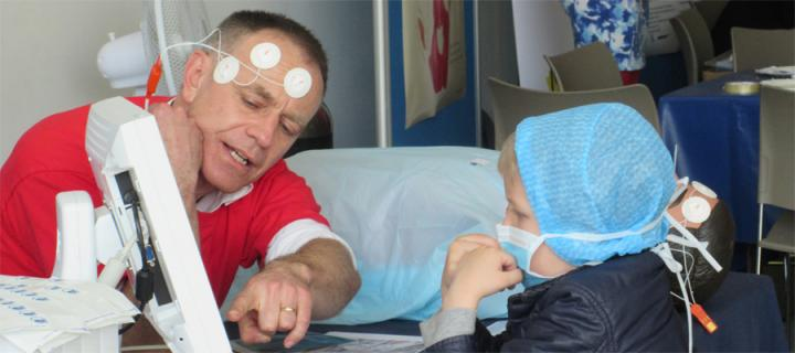 Tim Walsh gives demonstration of medical equipment to a child dressed as a surgeon