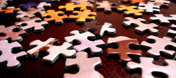 Image of jigsaw puzzle pieces on a table
