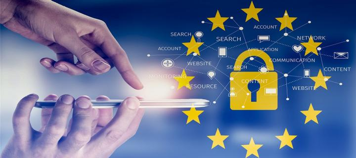 Image of a hand using a mobile device with a padlock and european union stars