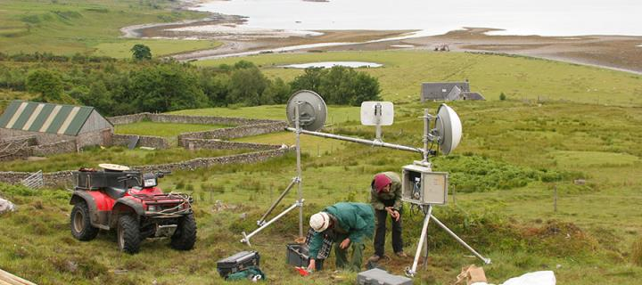 Photo of broadband being installed in rural farmland