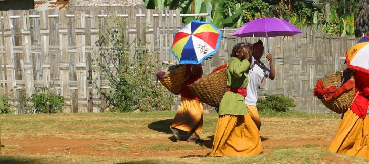 Photo of women using umbrellas to shade from the sun in an Ethopian village