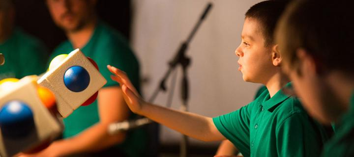 Photo of a school pupil playing with the Skoog accessible musical instrument