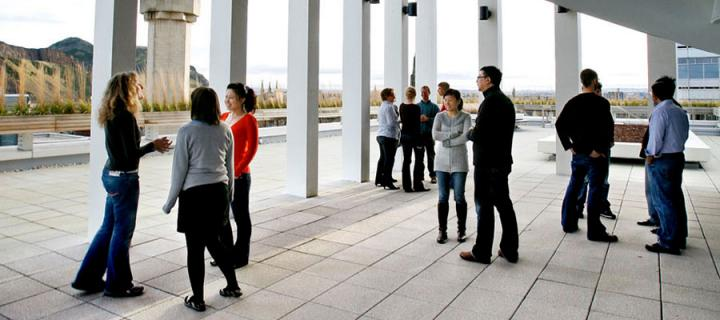 Photo of students and staff on the Informatics Forum rooftop
