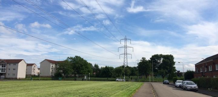 Sunny day, houses, playing field, pylons