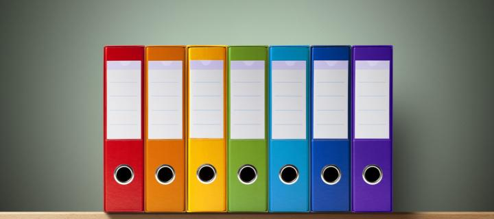 Image showing colourful ring binders on a shelf