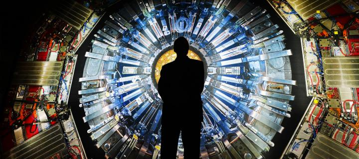 Silhouette of a man against the Large Hadron Collider, CERN, Switzerland