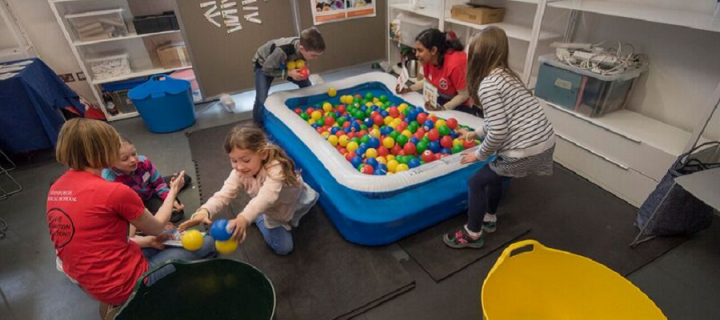 Image of children playing with a ball pool