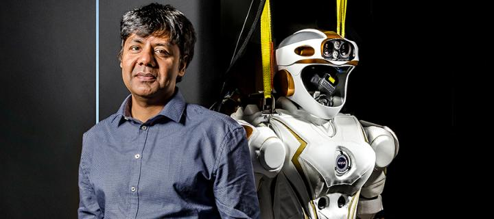 Professor Sethu Vijayakumar with the Valkyrie robot.
