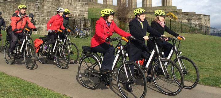 Staff cycling on Calton Hill
