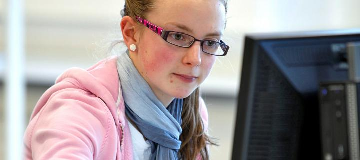 a female student working at a computer