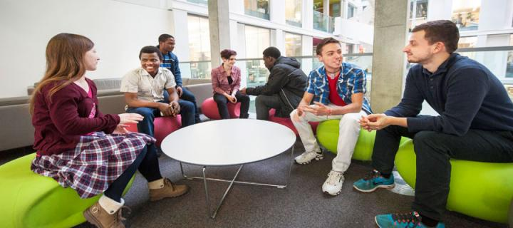 Photo of students talking inside the Informatics Forum