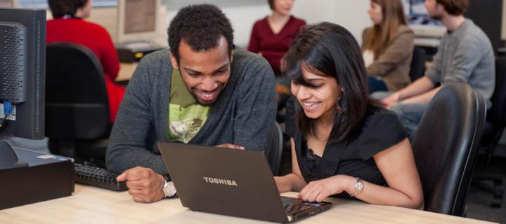 Two students sharing a laptop