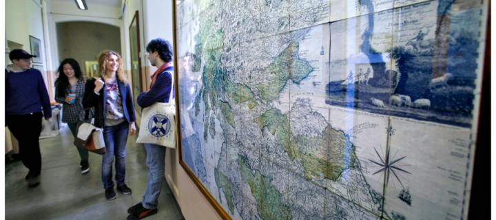 students next to map of scotland