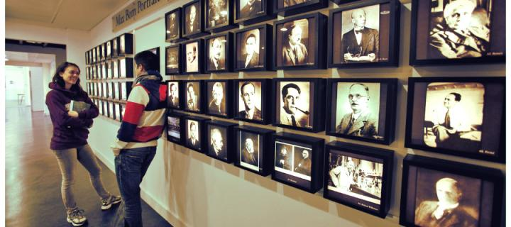 students next to photo gallery