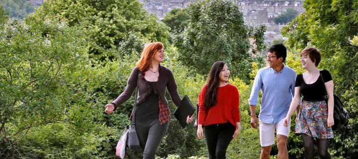A group of students walking up calton hill