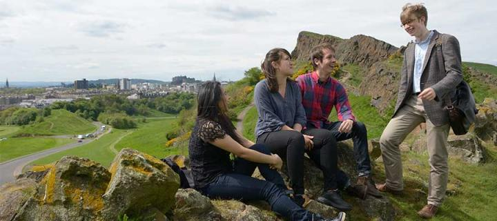 Students on Arthur's Seat overlooking the city