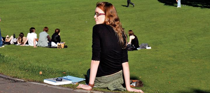 Photo of a student sitting in Princes Street gardens