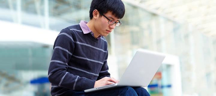 Photo of a student on a laptop