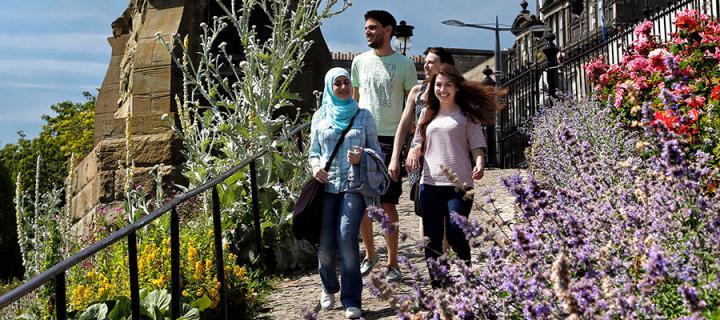 Photo of students walking through Princes Street gardens