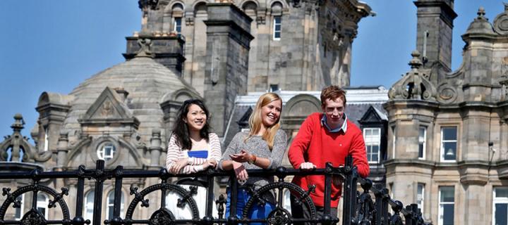 Three students outside in Edinburgh city centre