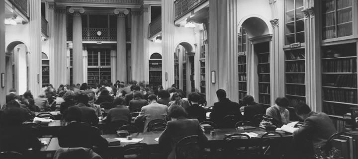 Old black and white photo of students studying