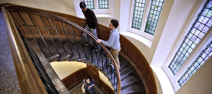 students climbing a staircase in New College