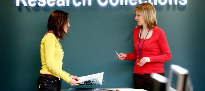 A member of staff helping a student at the Centre for Research Collections.