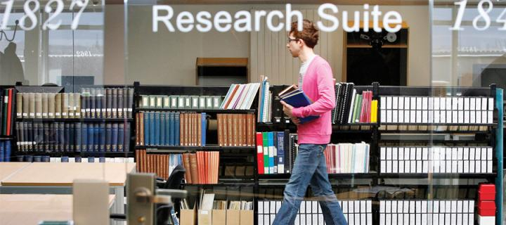 A male student in the Research Suite of the Main Library