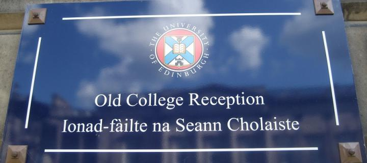 Bilingual sign outside Old College