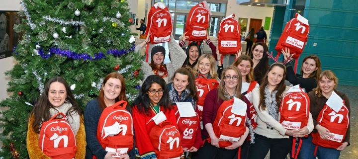 Vet students holding the bags collected for homeless people and their pets