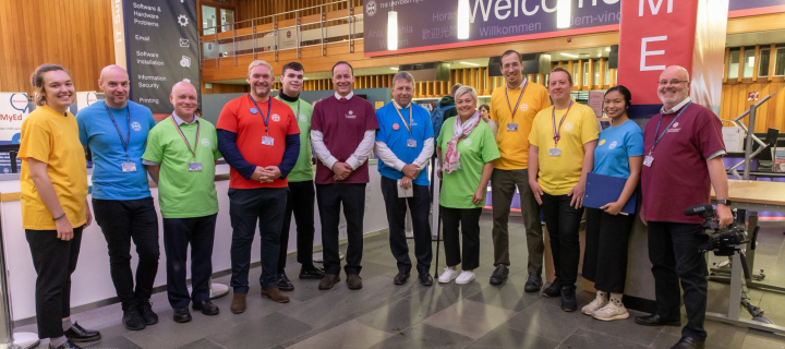 Group photo, including Peter Mathieson and Gavin McLachlan, at Welcome Week 2019 in the Main Library foyer