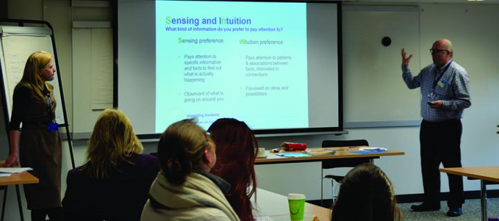 Two members of Careers Service staff delivering a training workshop with a view of a data projector in the background and some s