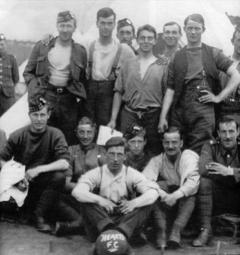Men of the 16th Royal Scots in France with one of the footballs sent out by Heart of Midlothian Football Club