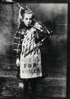 Image of Bessie Watson (aged 9) playing the pipes.