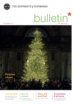 University of Edinburgh staff magazine cover image showing Christmas tree lit up in Old College