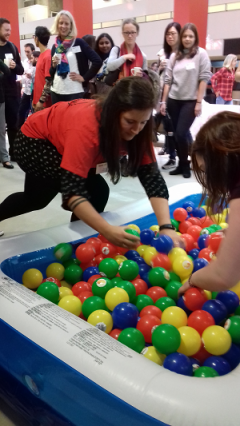 Staff playing the ball pool activity