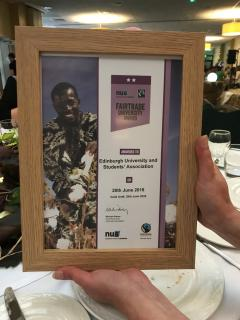 Picture of the University's Fairtrade Award, a plaque with a wooden frame and the logos of the NUS and Fairtrade Foundation