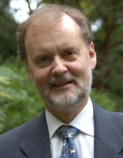 Head and shoulders photo of Professor Larry Hurtado in jacket and tie