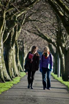 Two females walking on park path