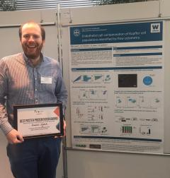 Image of Ruairi Lynch receiving best poster prize at the Macrophage Biology in the Single-Cell Era Meeting