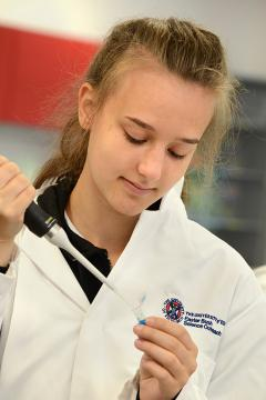 A student in the EBSOC lab