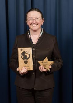 Sharon Boyd holding the awards.