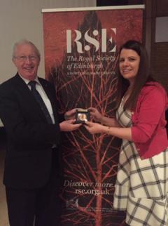 Professor Stuart Monro FRSE awarding Sinead her medal