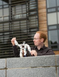 Alexander Enoch with Robot