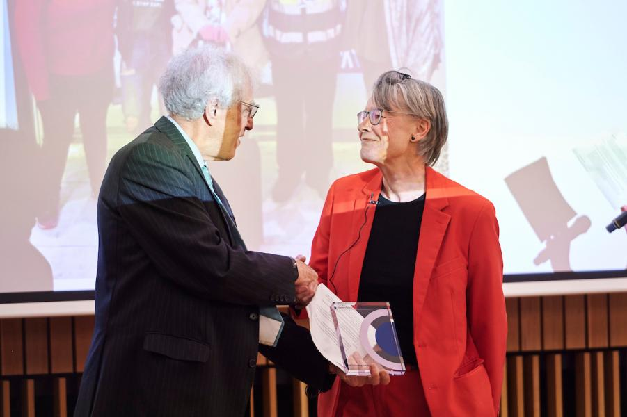 Alastair Salvesen presenting Sophie Dow with an award