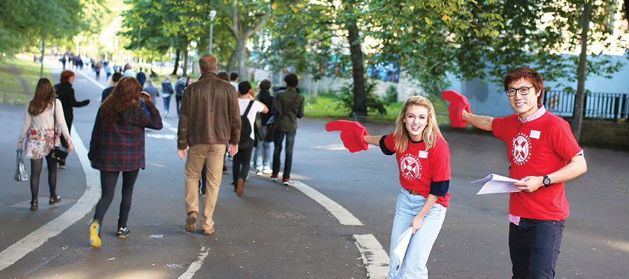 Student Ambassador wearing a red t-shirt